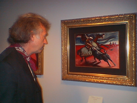 "Artist William Stout taking in Marc Davis' 1947 oil painting ""Blood and Sand""."