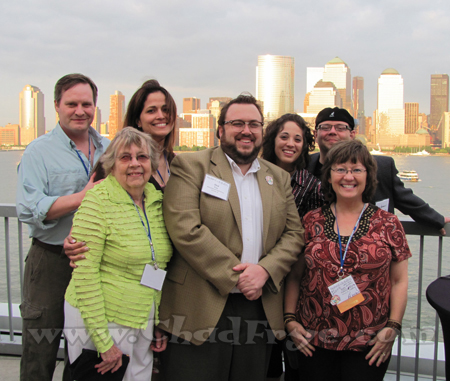"With a golden twilight New York City as a backdrop, ""Tundra"" artist Chad Carpenter, Bobbi Hart (Johnny Hart's wife), Karen Carpenter, Chad Frye, ___, Mason Mastroianni (""B.C."" artist) and Patti Pomeroy (Mason's mother and daughter of Johnny Hart)."