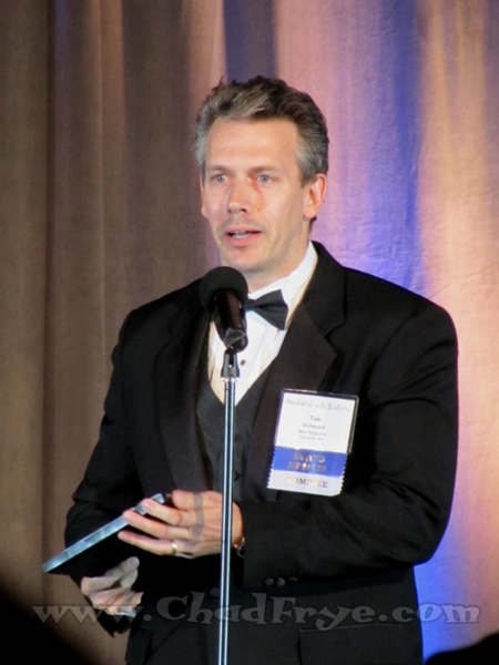 "Tom Richmond, known for his work in ""MAD Magazine"", was nominated for three awards that night, but is seen here accepting the Newspaper Illustration award, his only win of the evening."