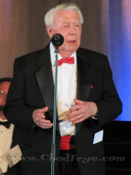 "Mort Walker (currently in his 60th year of ""Beetle Bailey"") as he announces the winner of The Reuben Award."