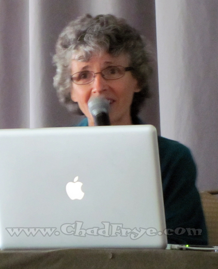 "Anne Gibbons of ""Six Chix"" doing her best Apple laptop ad."