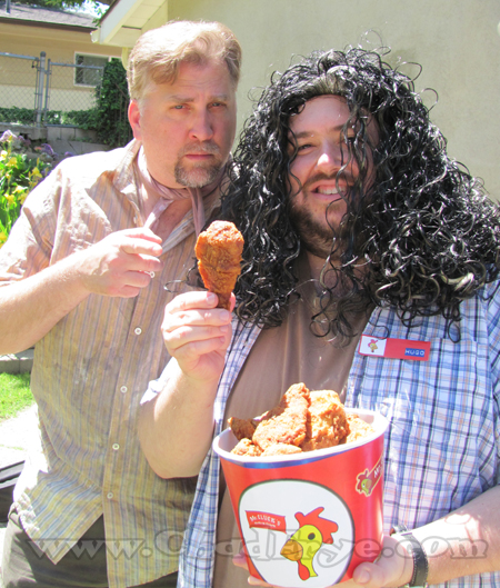 Dr. Leslie Arzt (Daniel Roebuck) and Hugo 'Hurley' Reyes (Chad Frye) with a bucket of Mr. Cluck's Chicken.